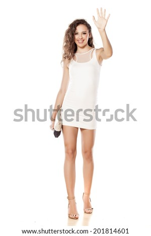 pretty girl in a short white dress waving hand - stock photo