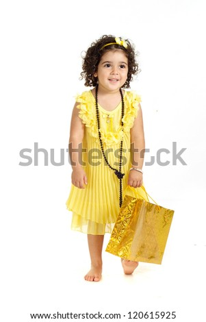 pretty girl in a yellow dress posing on a white background