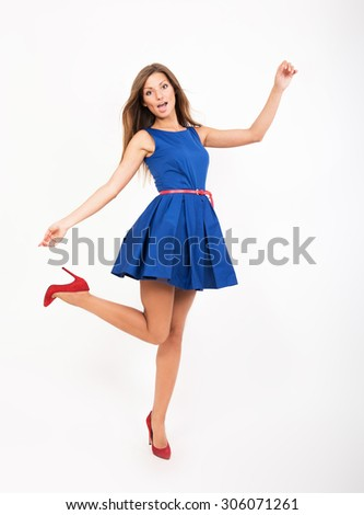 Pretty girl in blue dress, studio full length portrait - stock photo