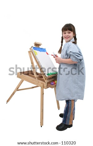 Pretty girl in braids and big shirt painting at a wooden easel.
