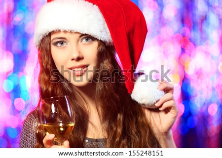 Pretty girl in Christmas clothes on a party. Disco lights in the background. - stock photo