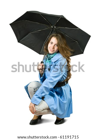 Pretty  girl in cloak with umbrella. Isolated over white