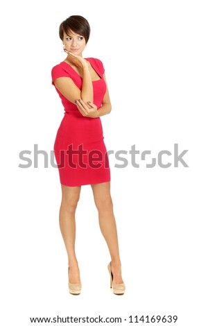 Pretty girl in coral dress on a white background - stock photo