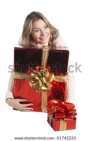 Pretty girl in cozy white sweater with red presents