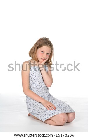 pretty girl in dress kneeling and pouting