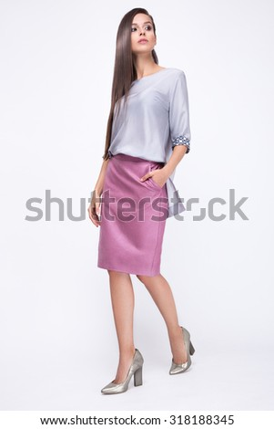 Pretty girl in fashionable stylish clothes, walking on a white background. Beauty, fashion, style. - stock photo
