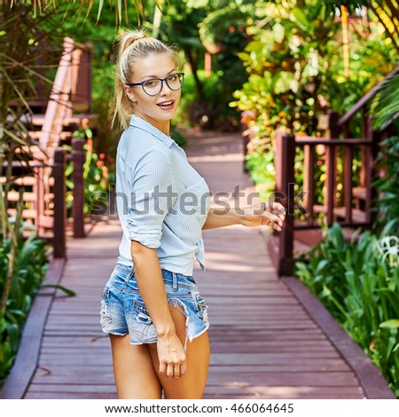 Pretty girl in glasses outdoor portrait