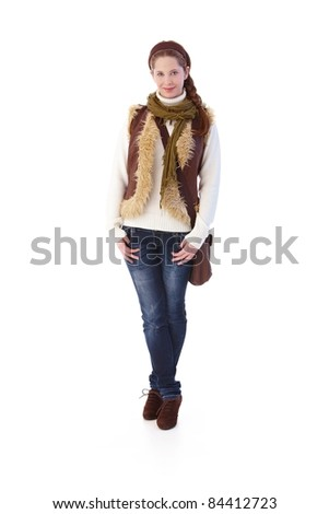 Pretty girl in jeans and pullover smiling.? - stock photo