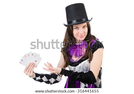 Pretty girl in jester costume with cards isolated on white - stock photo