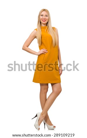 Pretty girl in ocher dress isolated on white - stock photo
