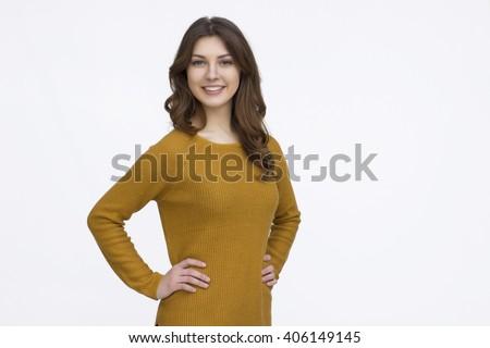 Pretty girl in orange sweater - stock photo