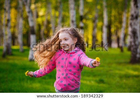 Pretty girl in park.   girl running in the park. Wind blows hair. Happiness, smile  - stock photo