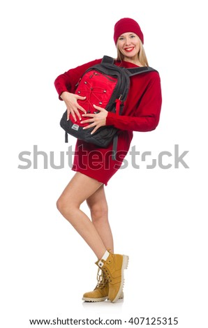 Pretty girl in red dress and backpack isolated on white - stock photo