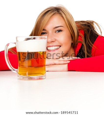 pretty girl in red drinking beer from the mug, white background - stock photo