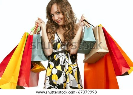 Pretty girl in red glasses admiring her shopping - stock photo