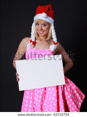 pretty girl in santa cloth with a tablet for congratulations in the hands - stock photo