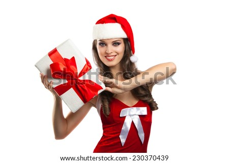 pretty girl in santa hat with Christmas present. Isolation on a white background