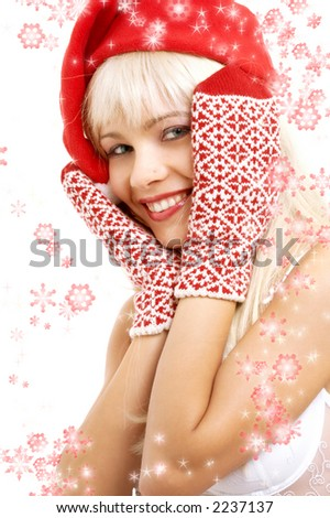 pretty girl in santa helper hat surrounded by rendered snowflakes - stock photo