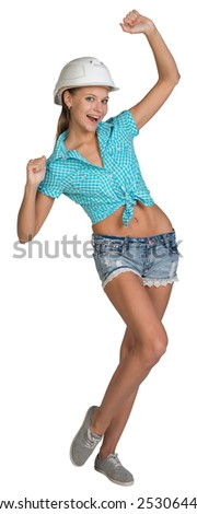 Pretty girl in shorts, shirt and white helmet happily raised his hands up. Full length. Isolated over white background - stock photo