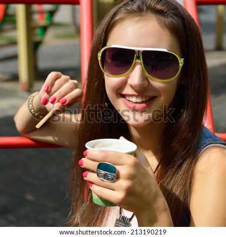 Pretty girl in sunglasses with paper cup of coffee, youth  lifestyle, outdoor portrait.  - stock photo