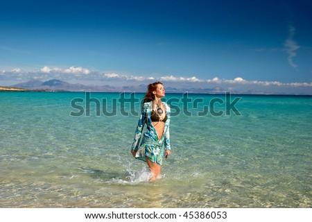 Pretty girl in the beach - stock photo