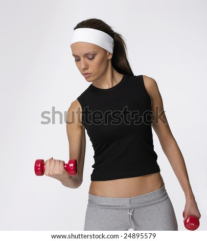 Pretty girl is concentrated in executing an exercise