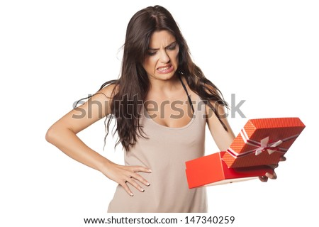 pretty girl is not happy and is disgusted her gift - stock photo