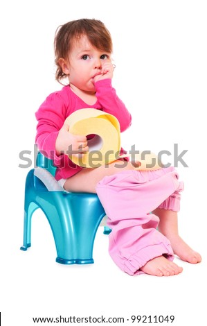 Pretty girl is sitting on the pot, holding a roll of paper, sucking her finger. isolated on white - stock photo