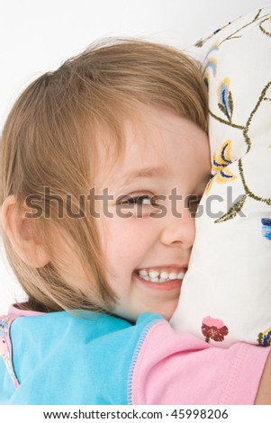 Pretty girl jokes to pretend to be sleeping - stock photo