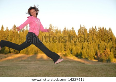 pretty girl jumping in a air - stock photo