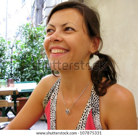 Pretty girl laughing in cafe