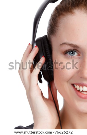 Pretty girl listening music and smiling to you. Isolated on white background. - stock photo