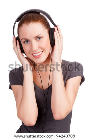 Pretty girl listening music, isolated on white background - stock photo