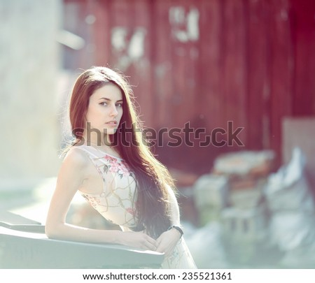 Pretty girl looking in camera - stock photo