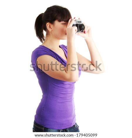 Pretty girl making photo using classic slr camera. Isolated on white - stock photo