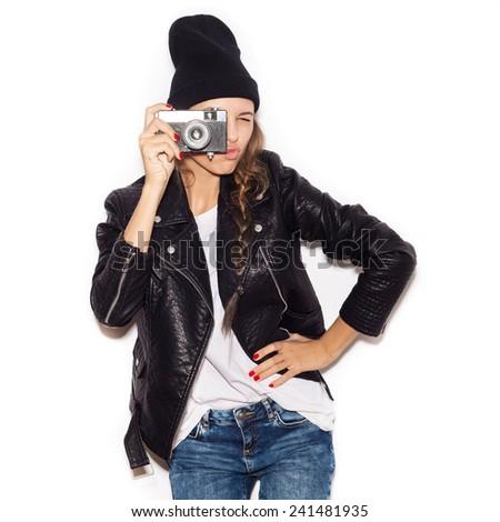 Pretty girl making photo using noname retro camera. White background, not isolated - stock photo