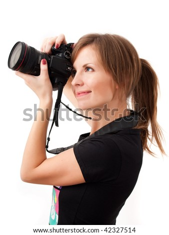 Pretty girl making photo using professional camera. Over white