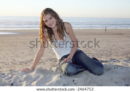 Pretty girl on sand - stock photo