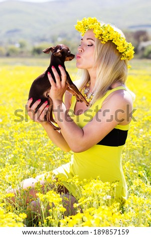 Pretty girl on the nature with her dog - stock photo