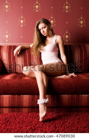 Pretty girl on the red sofa.