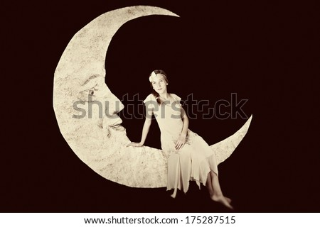 Pretty girl on vintage paper moon - stock photo