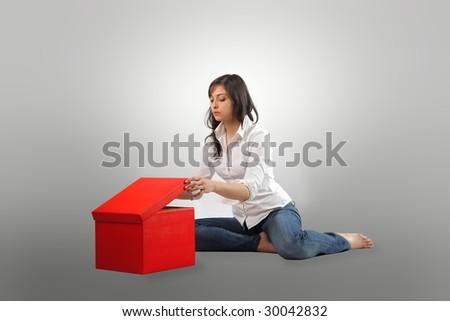 pretty girl open a big red box - stock photo