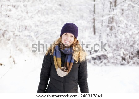 Pretty girl outside toasty warm in Winter - stock photo