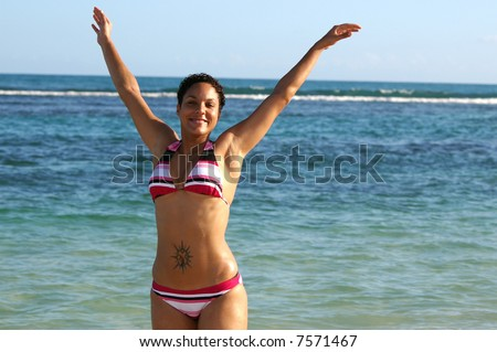 pretty girl playing at the beach - stock photo