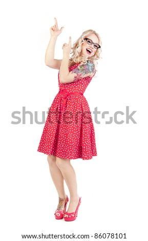 Pretty girl pointing up - stock photo