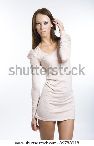 Pretty girl posing in a nice dress - stock photo