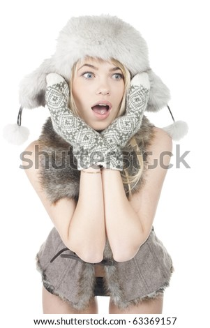 Pretty girl posing in winter clothes - stock photo