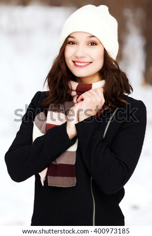 Pretty girl posing outdoors - stock photo
