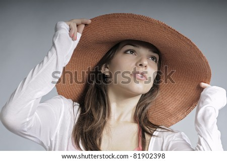 pretty girl posing with hat