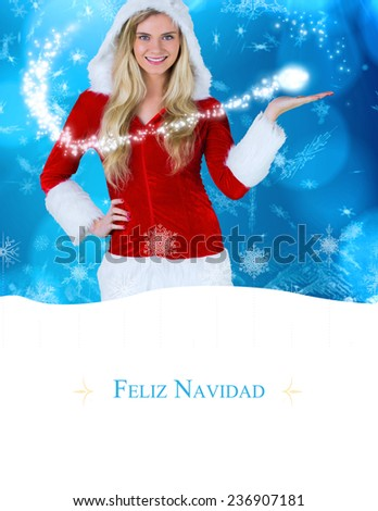 pretty girl presenting in santa outfit against border - stock photo
